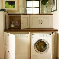 BHG - laundry/mud rooms - white, front-load, washer, dryer, hidden, white, cabinets, butcher block, countertops,  White front-load washer & dryer