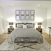 Marie Burgos Design - bedrooms - rug, upholstered bed, oak floors, cowhide bench, silver bedding, silver duvet, silver shams,  The master bedroom