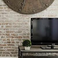Marie Burgos Design - living rooms - Benjamin Moore - Decorators White - wall clock, Tv stand, oak floors, brick wall,  The living room combines