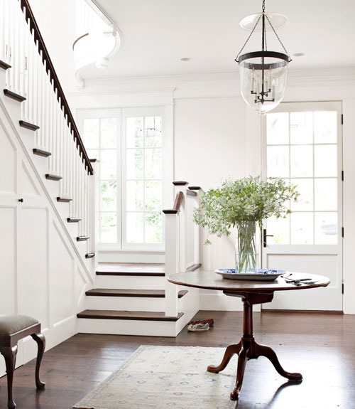 Darryl Carter - entrances/foyers - Benjamin Moore - Huntington White - 19th, century, leather, top, pedestal, table, Persian, Tabriz, rug, glass, lantern, pendant,