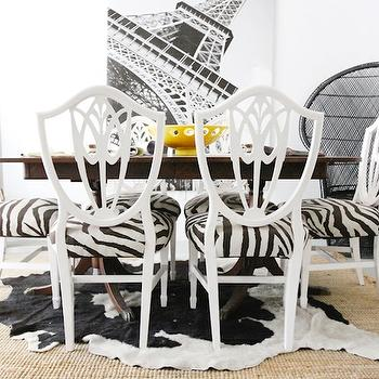 The Every Girl - dining rooms - glossy, white, shield back, chairs, zebra, cushions, wood, dining table, black, white, cowhide, rug, layered, jute, rug, shield back chairs, upholstered shield back chairs, white shield back chairs, zebra shield back chairs,