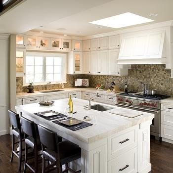 Mueller Nicholls - kitchens - skylight, white, kitchen cabinets, kitchen island, marble, countertops, small, sink in kitchen island, mosaic, tiles, backsplash, brown, leather, counter stools, kitchen skylight, skylight kitchen, skylight in kitchen,