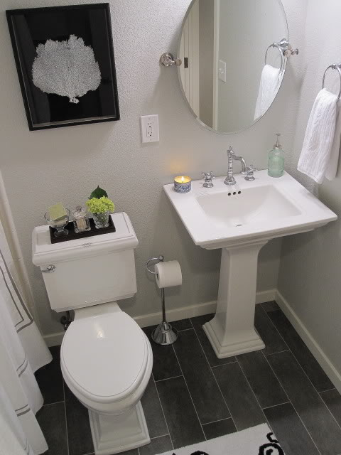 Freckles Chick - bathrooms - Benjamin Moore - Gray Owl - grey plank style ceramic floor tiles, pedestal sink, Kohler Memoirs, Carrington chrome vintage looking faucet, nautical light, oval mirror, gray walls, gray paint, gray paint colors,