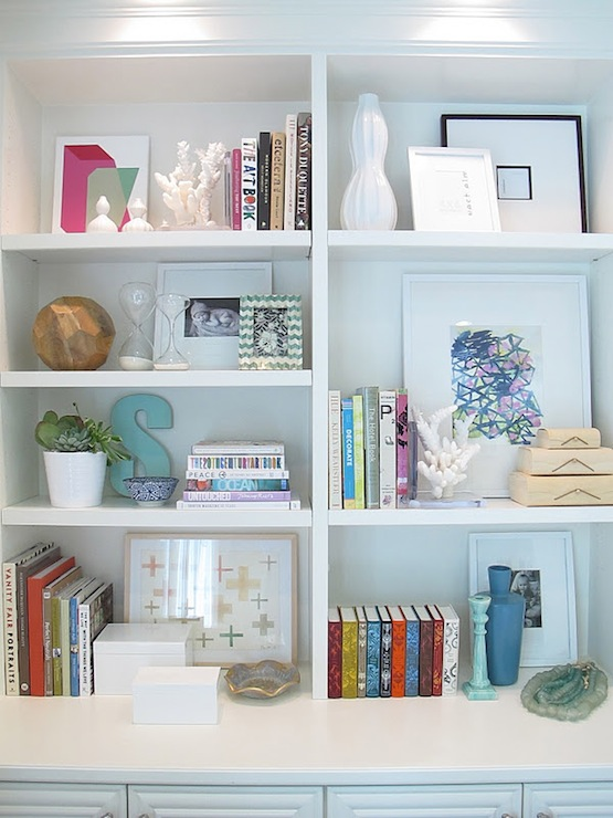 Amber Interiors - dens/libraries/offices - white, lacquer, boxes, cacti, books,  Living room built-in bookcase vignette with books, teal blue