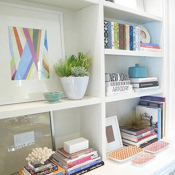 Amber Interiors - dens/libraries/offices - built-ins, vignette, pink, orange, geometric, pattern, trays, bookcase vignette, styled bookcase,