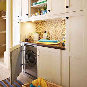 BHG - laundry/mud rooms - striped, brown, blue, rug, silver, front-load, washer, dryer, hidden, ivory, utility, cabinets, mosaic, glass, tiles, backsplash, hidden washer and dryer,