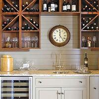 Amazing butler's pantry with light gray kitchen cabinets, white granite countertop, wine ...