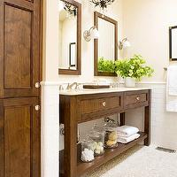 BHG - bathrooms - bronze, crystal chandelier, coffee stained, double bathroom vanity, pebble, floor, pencil rail, subway tiles, backsplash,