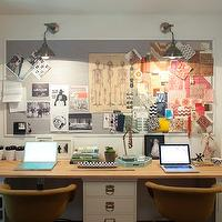 office for two with gray bulletin board, industrial sconces, wood top desk ...