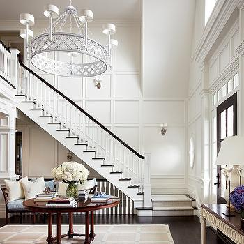 Architectural Digest - entrances/foyers - two story, foyer, round, console, table, bench, glossy, black, door, wainscoting, floor to ceiling wainscoting,