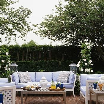 Ashley Whittaker Design - decks/patios - brick, pavement, herringbone, pattern, white, lattice, sofa, chairs, blue, cushions, navy blue, piping, outdoor, tables, brick herringbone, brick herringbone floor,