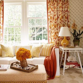 Ashley Whittaker Design - living rooms - yellow, orange, drapes, white, slipcover, sofa, orange, throw, yellow, pillows, mustard, yellow, gourd, lamp, white, end table, woven, ottoman, diamond, pattern, seagrass, rug, white, lattice, walls, ceiling, orange drapes, orange curtains, orange window panels,