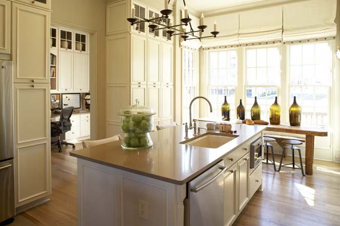 Westbrook Interiors - kitchens - white, kitchen island, gray, quartz, countertop, iron, chandelier, sink in kitchen island, rustic, wood, dining table, industrial, stools, green, glass, bottles, white, roman shades, floor to ceiling cabinets, floor to ceiling kitchen cabinets,
