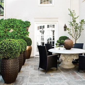 Atlanta Homes & Lifestyles - decks/patios: slate, pavers, marble, round, outdoor, dining table, black, outdoor, chairs, dining set, outdoor dining set,