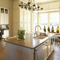 Westbrook Interiors - kitchens - white, kitchen island, gray, quartz, countertop, iron, chandelier, sink in kitchen island, rustic, wood, dining table, industrial, stools, green, glass, bottles, white, roman shades,