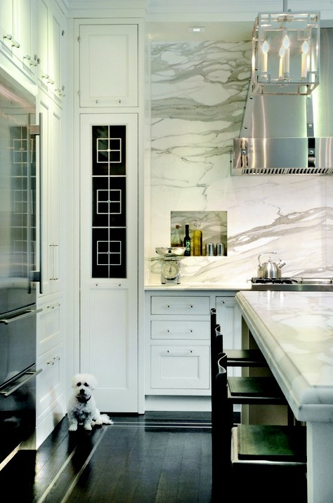 Meyer Davis Studio - kitchens - white, kitchen cabinets, kitchen island, beveled, marble, slab, countertops, backsplash, polished nickel, lantern, calcutta gold marble, calcutta gold, calcutta gold marble backsplash, calcutta gold marble backsplash tile, calcutta gold marble kitchen, calcutta gold marble backsplash kitchen,