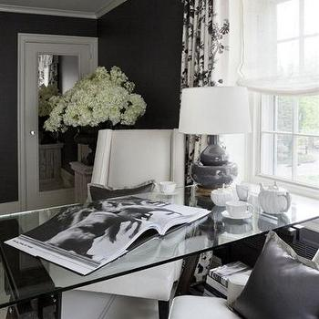 Joel Woodward - dens/libraries/offices - bold, black, walls, white, black, toile, valance, drapes, purple, gourd, lamp, glass-top, sawhorse, desk, white, curvy, chairs, white, lattice, rug. sawhorse desk, glass sawhorse desk,