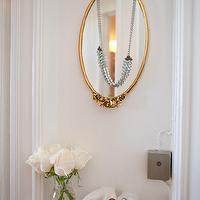 Apartment Therapy - entrances/foyers - hands, oval, gold, mirror, cupped hands, cupped hands tray, wall mounted cupped hands,  Eclectic foyer