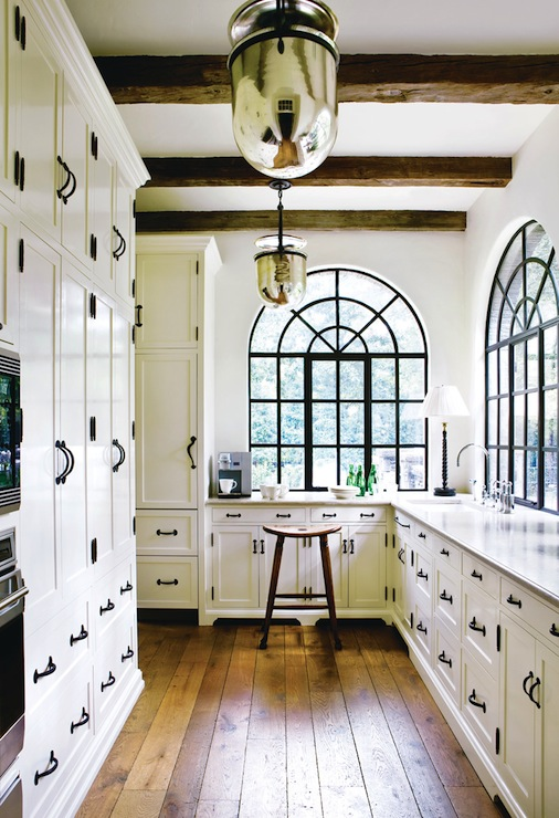 Atlanta Homes & Lifestyles - kitchens - hand scraped, wood floors, mirrored, lanterns, pendants, arched windows, white, floor to ceiling, kitchen cabinets, rustic, wood beams,