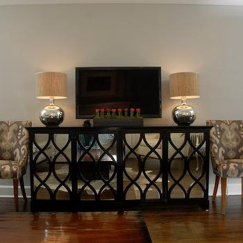 Shannon Connor Interiors - living rooms - gray, walls, TV, gray, ikat, chairs, mirrored media cabinet, black media cabinet, black mirrored cabinet, black mirrored media cabinet, mirrored 4 door cabinet, 4 door mirrored cabinet, , Oly Studio Elisabeth Four Door Buffet With Antiqued Mirror,