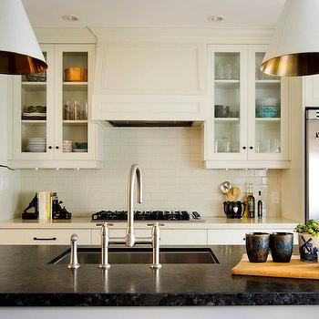 Buchman Photo - kitchens - ivory, glass-front, kitchen cabinets, subway tiles, backsplash, kitchen island, honed, black, marble, countertops, sink in kitchen island, black marble, black marble countertops, black marble counters, black marble top, honed black marble,