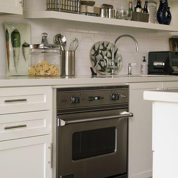 Thom Filicia - kitchens - gooseneck, faucet, chunky, off-white, floating shelves, off-white, kitchen cabinets, white, quartz, countertops, subway tiles, backsplash, floating shelves, white floating shelves, floating kitchen shelves, kitchen floating shelves,