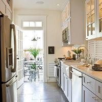 Paul Corrie Interiors - kitchens - farmhouse, sink, white, glass-front, kitchen cabinets, marble, countertops, galley kitchen, white galley kitchen, traditional galley kitchen, galley kitchen design, galley kitchen cabinets, white galley cabinets, white galley kitchen cabinets, glass front galley cabinets, glass front galley kitchen cabinets,
