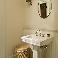 Jones Pierce Architects - bathrooms - ivory, walls, brown ribbon, hanging, oval, mirror, marble, rail, beadboard, backsplash, glossy, white, pedestal, sink, wicker, hamper, vintage, penny, tiles, floor, beadboard backsplash, beadboard bathroom, bathroom beadboard, white beadboard, white beadboard backsplash,