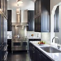 Thompson Suskind - kitchens - silver, pierced, pendants, gray, walls, glossy, black, kitchen cabinets, white, carrara, marble, slab, countertops, backsplash, espresso, wood, floors,