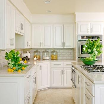 Tobi Fairley - kitchens - travertine tiles, quartz countertops, white quartz countertops, kitchen island cooktop, island microwave, kitchen island microwave,
