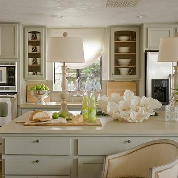 Giannetti Home - kitchens - pale, gray, green, kitchen cabinets, kitchen island, corian, countertops, alabaster, lamps, cream cabinets, cream kitchen cabinets,