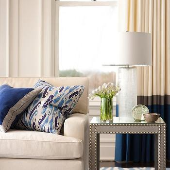 Muse Interiors - living rooms - ivory, blue, drapes, gray, walls, ivory, sofa, nailhead trim, blue, ikat, pillow, gray, end table, nailhead trim, blue, zebra, rug, gray table, gray ned table, gray end table with nailhead trim, studded end table, nailhead end table,