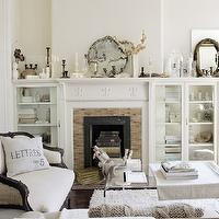 Country Living - living rooms - fireplace, flanked, built-ins, French, settee, vintage, pillow,  Chic, elegant living room with French settee,