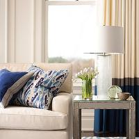 Muse Interiors - living rooms - ivory, blue, drapes, gray, walls, ivory, sofa, nailhead trim, blue, ikat, pillow, gray, end table, nailhead trim, blue, zebra, rug,