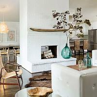 Jessica Helgerson Interior Design - living rooms - white, brick, fireplace, recycled, glass, vases, bottles, white, tufted, leather, sectional, sofa, brown, cowhide, rug, 2 sided fireplace, two sided fireplace, white brick fireplace, 2 sided brick fireplace, two sided brick fireplace, double sided fireplace,