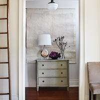 Gorgeous foyer with schoolhouse pendant, tapestry, gray washed chest and gray walls.