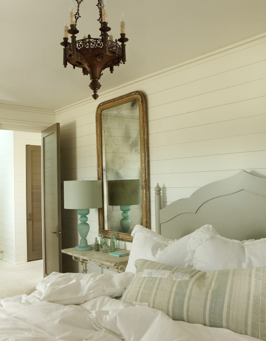 The Iron Gate - bedrooms - wall paneling, gold leaf, arched, mirror, blue, glass, vintage, lamp, light gray, carved, headboard, bed, vintage, pale, blue, lumbar pillow, gray headboard, gray wood headboard,