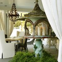 The Iron Gate - decks/patios - beaded, wood, chandelier, white, slipcover, wingback, chairs, covered deck, covered patio,  Chic covered patio