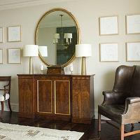 Phoebe Howard - living rooms - art gallery, gold, oval, mirror, antique, cabinet, console, tapered, glass, lamps, brown, leather, wingback, chair, silver, nailhead trim, leather chair, wingback chair, leather wingback chair, wingback leather chair, brown leather chair, brown leather wingback chair,