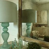 The Iron Gate - bedrooms - wall paneling, rustic, wood, mirror, blue, glass, vintage, lamp, recycled, glass, bottles, vignette, turquoise lamp, turquoise table lamp, turquoise blue lamp, glass lamp, turquoise glass lamp,