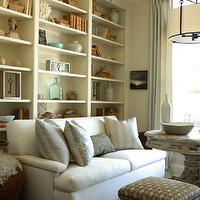 The Iron Gate - living rooms: wall, white, built-ins, nickel, picture, lights, white, sofa, silver, nailhead trim, white, washed, wood, pedestal, table, blue, silk, drapes, floor to ceiling cabinets, floor to ceiling built ins, floor to ceiling built in cabinets, floor to ceiling bookcases,