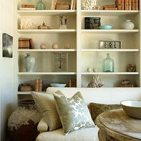 The Iron Gate - living rooms - wall, white, built-ins, white, sofa, silver, nailhead trim, silk, stripe, floral, blue, pillows, wall of built ins, wall of built in cabinets, floor to ceiling built ins, floor to ceiling built in cabinets,