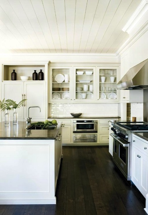 Suzanne Kasler - kitchens - white, paneled, ceiling, white, glass-front, kitchen cabinets, sink in kitchen island, black, granite, countertops, subway tiles, backsplash,
