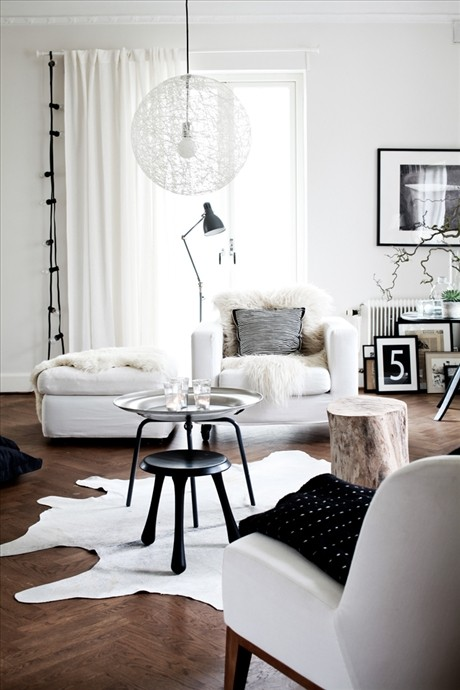 Skonahem - living rooms - white, chaise lounge, wood floors, herringbone, pattern, black, tripod, stool, table, white, cowhide, rug, tray, table,