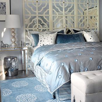 Mabley Handler - bedrooms: gray, blue, walls, light gray, linen, ottomans, mirrored, tables, nightstands, gold, trim, silver, garden stools, champagne, metal, lamps, ivory, mirrored, quatrefoil, floor screen, headboard, mirrored headboard, mirror headboard, mirror nightstand, mirrored nightstand, mirrored bedside table,