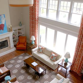 Mabley Handler - living rooms - 2 story ceiling, coral, drapes, teal, blue, coral, silk, pillows, white, modern, sofas, turquoise, blue, pillows, fireplace, white, drum, pendant, orange, trim, orange drapes, orange curtains, orange window panels, Madeline Weinrib Atelier Platinum Mandala Rug,