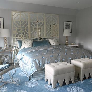 Mabley Handler - bedrooms: gray, blue, walls, ivory, mirrored, quatrefoil, pattern, floor screen, headboard, light gray, linen, tufted, ottomans, mirrored, table, nightstands, gold, trim, champagne, metal, lamps, mirror headboard, mirrored headboard, mirrored bed,