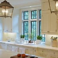 kitchens - twin, polished nickel, bridge, faucets, side-by-side, sinks, white, kitchen cabinets, marble, countertops, iron, lanterns,  Gorgeous