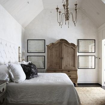 Tracery Interiors - bedrooms - vaulted ceiling, candle, chandelier, vintage, armoire, white, tufted, headboard, silk, black, rosette, pillow, antique armoire, french armoire, antique french armoire,