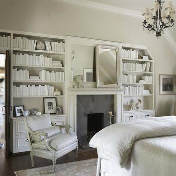 Tracery Interiors - bedrooms: white, built-ins, flanking, fireplace, French, chair, white, box beams, fireplace bookshelves, built in bookshelves, built in fireplace bookshelves,